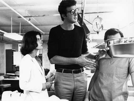 Michael Crichton and Genevieve Bujold on the set of COMA